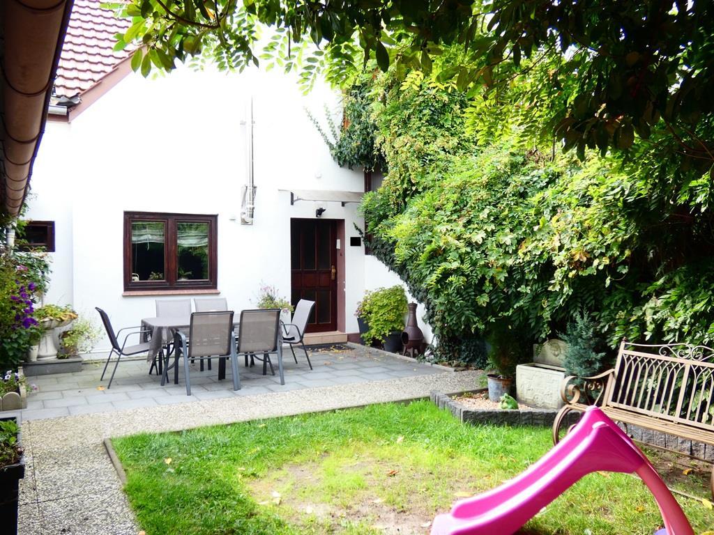 Wohnungseingang mit vorliegender Terrasse